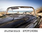 car on beach and summer time  | Shutterstock . vector #693914086