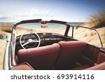car on beach and summer time  | Shutterstock . vector #693914116