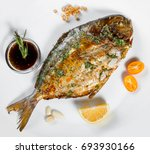 grilled dorado fish with greens ... | Shutterstock . vector #693930166