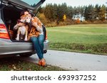 woman with her dog have a tea... | Shutterstock . vector #693937252