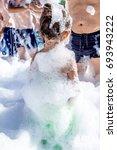 people in foam at a foam party | Shutterstock . vector #693943222