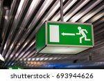 emergency exit sign at an... | Shutterstock . vector #693944626