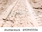 auto tracks on the sand | Shutterstock . vector #693945556
