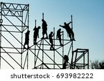 on the scaffolding the workers... | Shutterstock . vector #693982222