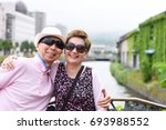 happy couple smiling to camera... | Shutterstock . vector #693988552