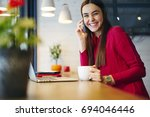 portrait of cheerful brunette... | Shutterstock . vector #694046446