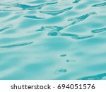 blue child pool water with sun... | Shutterstock . vector #694051576
