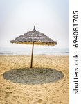 Straw Umbrella In Beach