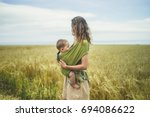A Young Mother With Her Baby I...