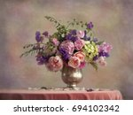 still life flowers in a silver... | Shutterstock . vector #694102342