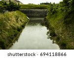 Small photo of Architectural and vegetal landscape in the island of Aix with canal