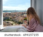 woman sitting on the bed in the ... | Shutterstock . vector #694157155