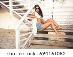 pretty young woman sitting on...   Shutterstock . vector #694161082