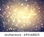 golden bokeh texture blurred.... | Shutterstock . vector #694168825