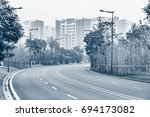 empty road at morning foggy... | Shutterstock . vector #694173082