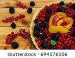 delicious tart with red... | Shutterstock . vector #694176106