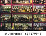 Small photo of Kiev, Ukraine - August 2017: Bar counter with a lot of bottles with alcohol at one of Kiev bars, Ukraine