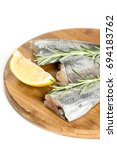 Small photo of Raw hake fish with lemon and rosemary branches on the wooden board.