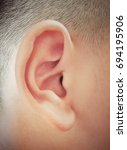 eight year old boy's ear  close ... | Shutterstock . vector #694195906