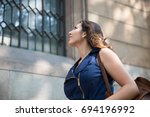 smiling young female traveler... | Shutterstock . vector #694196992