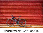 Bicycles Parking Against Red...