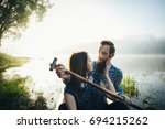 wife with husband sitting in... | Shutterstock . vector #694215262
