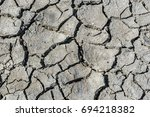 top view of drought cracked... | Shutterstock . vector #694218382