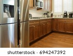 stainless steel appliances in... | Shutterstock . vector #694247392