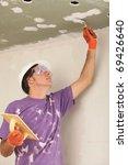 man holding a trowel | Shutterstock . vector #69426640