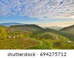 beautiful sunrise mountain on...   Shutterstock . vector #694275712