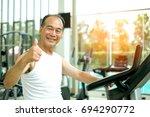 happy strong asian senior man... | Shutterstock . vector #694290772