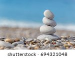 pile of pebble stones at french ... | Shutterstock . vector #694321048