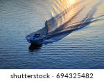 boat wake on water surface in... | Shutterstock . vector #694325482