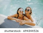 Two Young Women Having Fun In...
