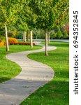 curved pedestrian sidewalk ... | Shutterstock . vector #694352845