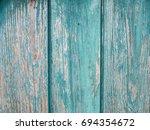old grunge green wood texture...   Shutterstock . vector #694354672