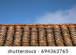 old roof and sky in background | Shutterstock . vector #694363765