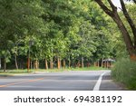 natural road with trees along... | Shutterstock . vector #694381192