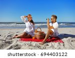summer beach with ocean and two ...   Shutterstock . vector #694403122