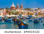 traditional eyed colorful boats ... | Shutterstock . vector #694414132