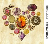 gems and precious stones arranged in heart shape on grunge paper background - stock photo