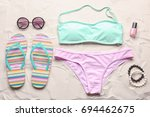 swimsuit and beach accessories...   Shutterstock . vector #694462675