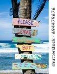 """Small photo of Bathsheba, Barbados – January 29, 2017: Creative appeal on the beach to protect the environment """"Please leave nothing but your footprints!"""""""