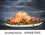delicious golden roasted... | Shutterstock . vector #694487095