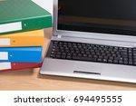 a tidy timber office desk... | Shutterstock . vector #694495555