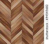 Small photo of Seamless wood parquet texture (chevron brown)