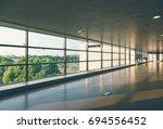 empty corridor with shadow in...   Shutterstock . vector #694556452