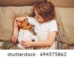 sick baby girl and puppy under... | Shutterstock . vector #694575862