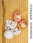 mushrooms and tomato on wooden... | Shutterstock . vector #694596112