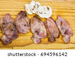 mushrooms and bacon on wooden... | Shutterstock . vector #694596142